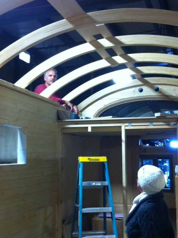 TURN ON IMAGES to see builder and friend admiring curved rafters